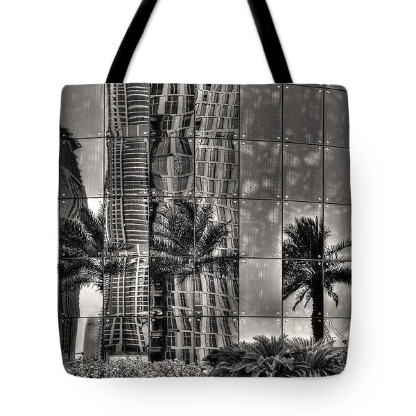 Tote Bag featuring the photograph Dubai Street Reflections by Julis Simo