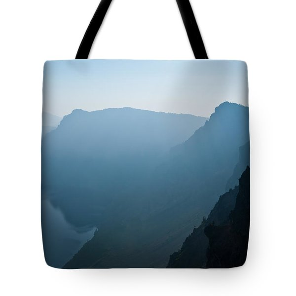 Tote Bag featuring the photograph Early Morning Fog Over Crater Lake by Jeff Goulden