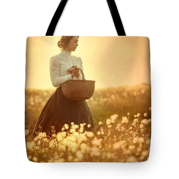 Edwardian Woman In A Meadow At Sunset Tote Bag by Lee Avison