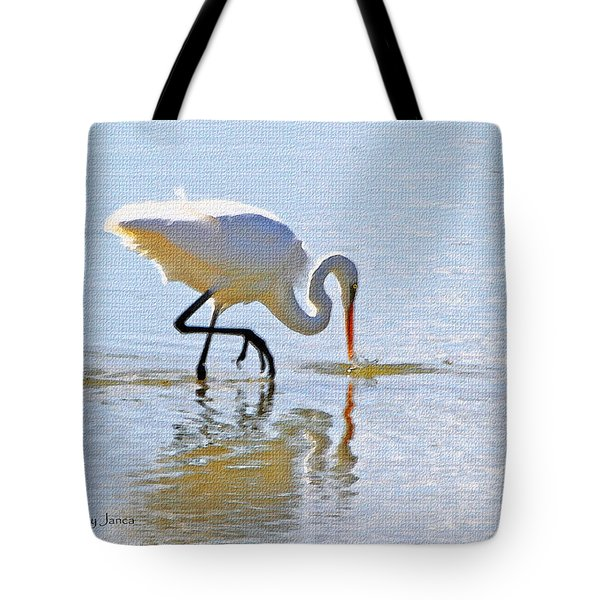 Egret Catches A Fish Tote Bag by Tom Janca