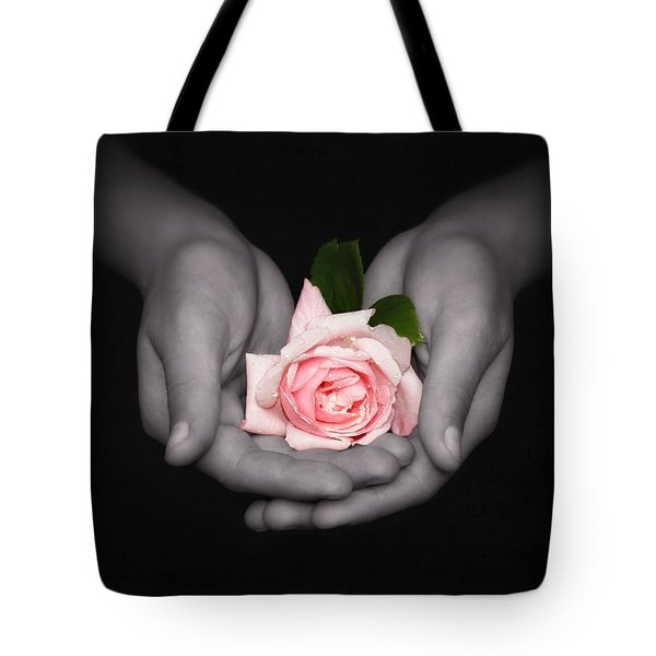 Tote Bag featuring the photograph Elegant Pink Rose In Hands by Tracie Kaska