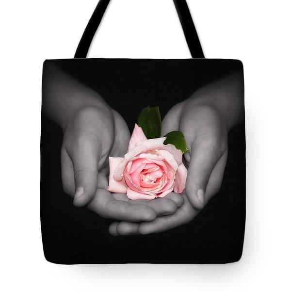 Elegant Pink Rose In Hands Tote Bag