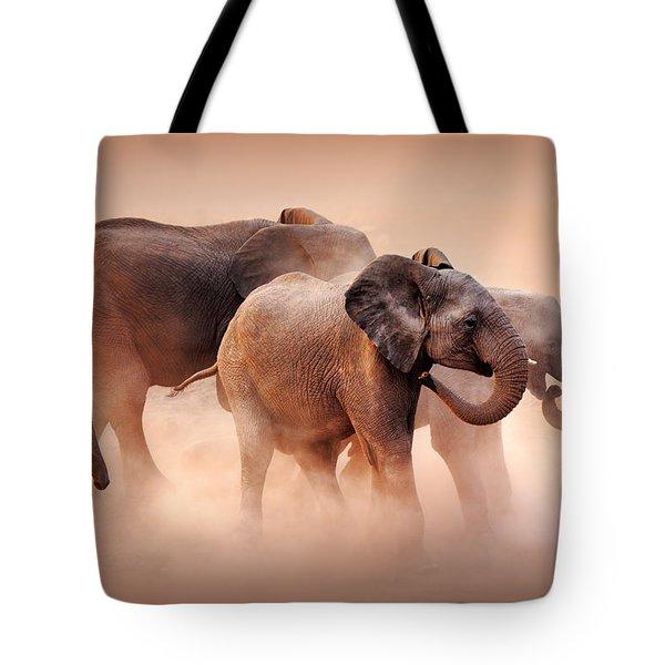 Elephants In Dust Tote Bag by Johan Swanepoel