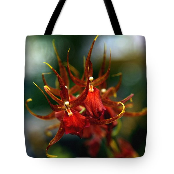 Embraced By An Orchid Tote Bag by Karen Wiles