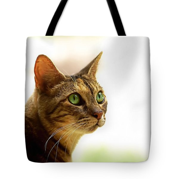 Tote Bag featuring the photograph Emerald Eyes by Olga Hamilton