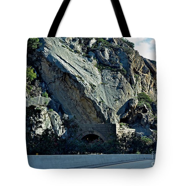 Tote Bag featuring the photograph Eroding Hillside And Tunnel by Susan Wiedmann