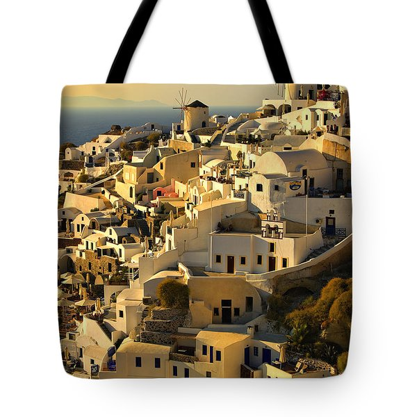 Tote Bag featuring the photograph evening in Oia by Meirion Matthias