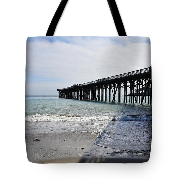 Tote Bag featuring the photograph Evening Pier Shadows Are Lost In The Surf by Debby Pueschel