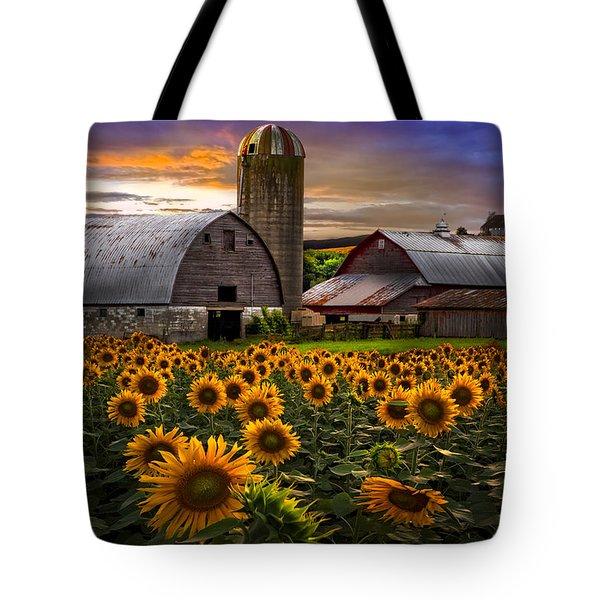 Evening Sunflowers Tote Bag by Debra and Dave Vanderlaan