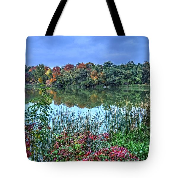 Tote Bag featuring the photograph Fall Colors At Blue Hour Near Zegrze by Julis Simo