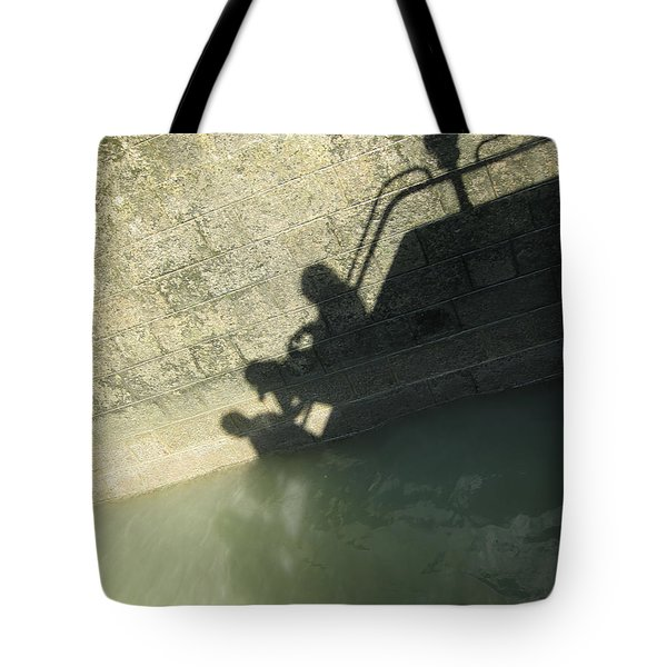 Tote Bag featuring the photograph Falling Into The Water by Menega Sabidussi