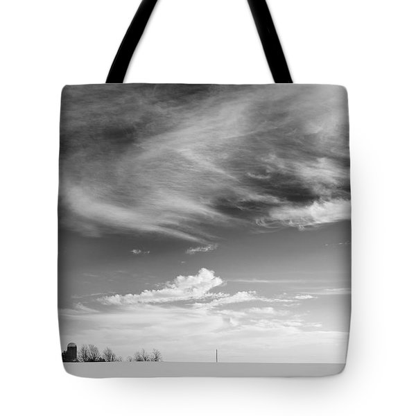 Farm In The Distance In A Snowy Field Tote Bag by Patrick LaRoque