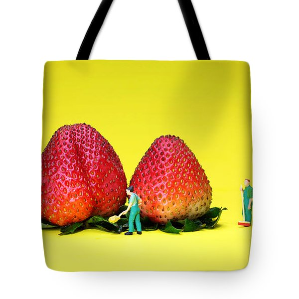 Farmers Working Around Strawberries Tote Bag by Paul Ge