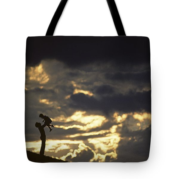 Father Holding Daughter Above His Head Along Hillside Silhouette Tote Bag