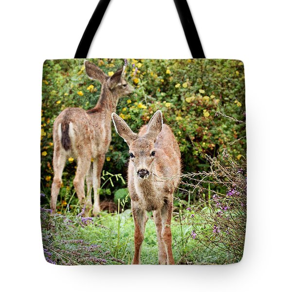 Tote Bag featuring the photograph Fawns Eating Flowers by Peggy Collins