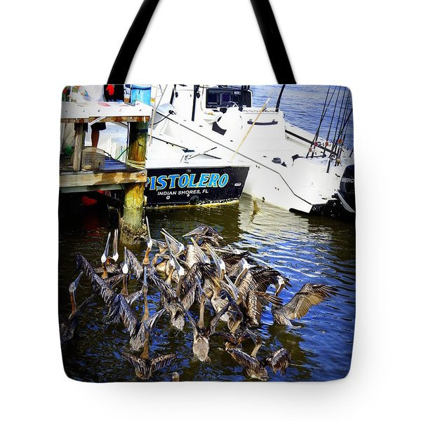 Tote Bag featuring the photograph Feeding Frenzy by Laurie Perry