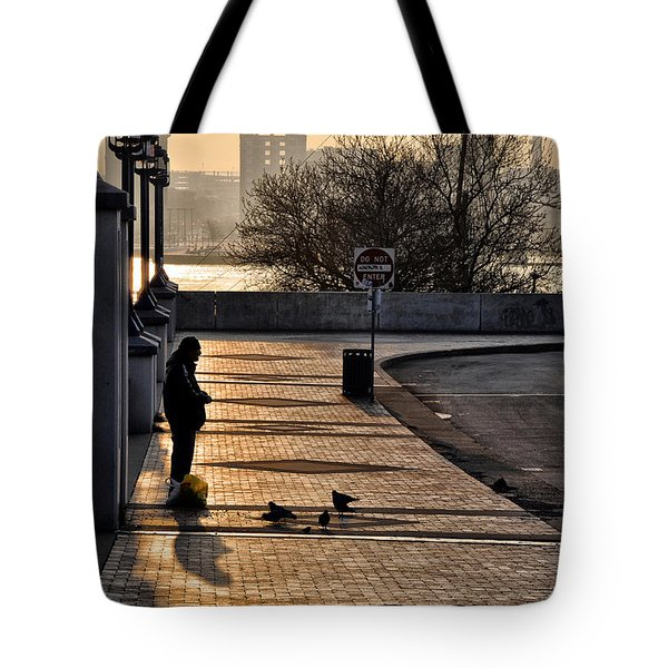Feeding The Birds At Dawn Tote Bag by Bill Cannon