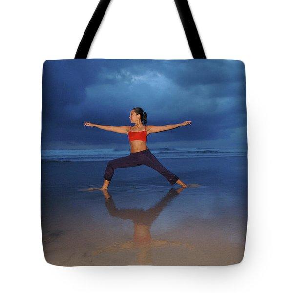 Female Performs Yoga On Beach Tote Bag