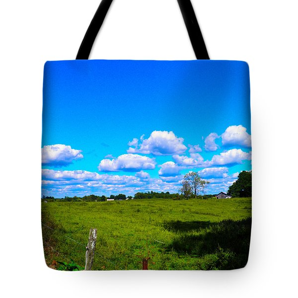 Fence Row And Clouds Tote Bag by Nick Kirby