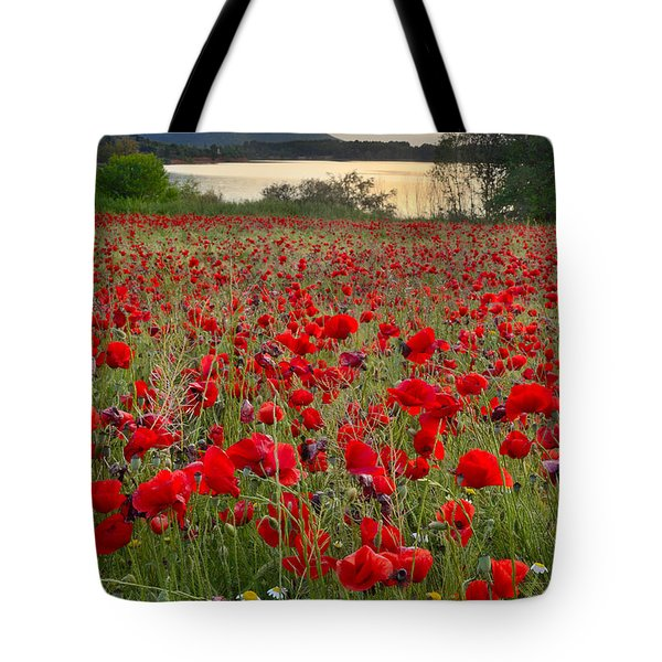 Field Of Poppies At The Lake Tote Bag by Guido Montanes Castillo