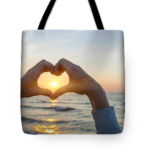 Fingers Heart Framing Ocean Sunset Tote Bag
