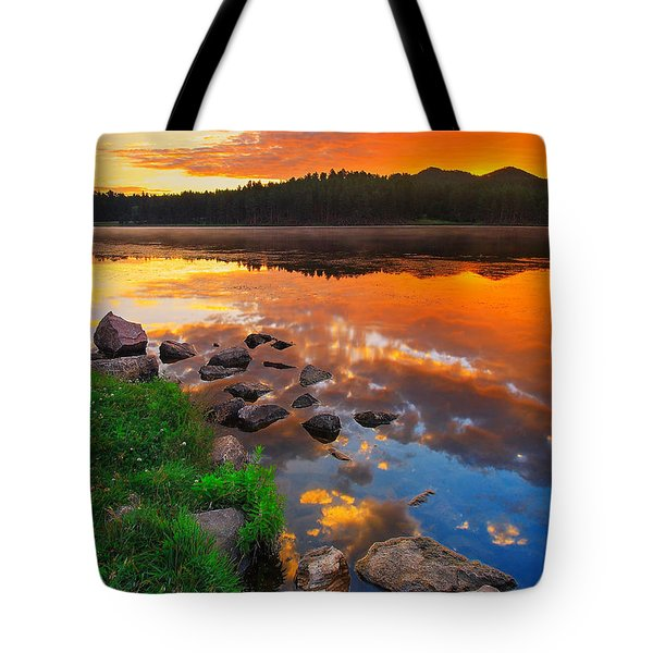 Tote Bag featuring the photograph Fire On Water by Kadek Susanto