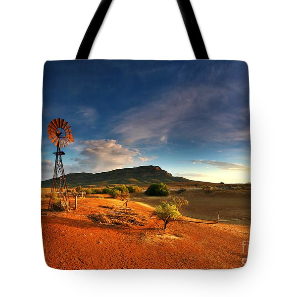 First Light On Wilpena Pound Tote Bag by Bill  Robinson