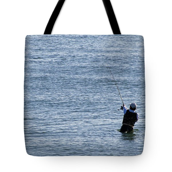 Tote Bag featuring the photograph First Striper Of The Season by Greg Graham