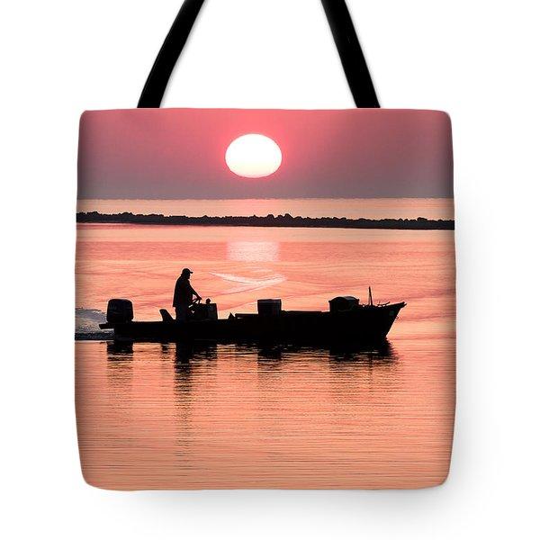 Fisherman At Sunrise Apalachicola Bay Florida  Tote Bag by Bill Swindaman