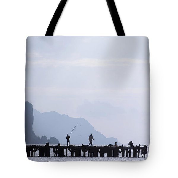 Fisherman At The Pier Tote Bag