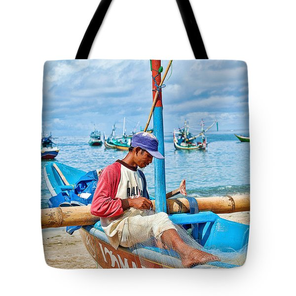 Tote Bag featuring the photograph Fisherman by Yew Kwang