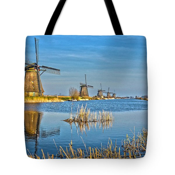 Tote Bag featuring the photograph Five Windmills At Kinderdijk by Frans Blok