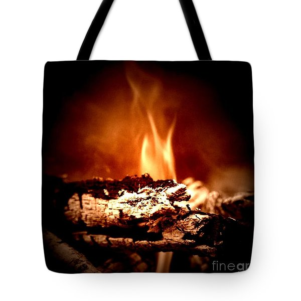 Tote Bag featuring the photograph Flame by Denise Tomasura