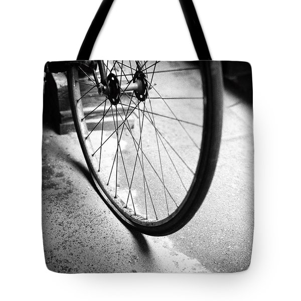 Tote Bag featuring the photograph Flat Bicycle Tire by Dave Beckerman