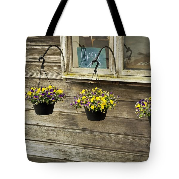 Flower Baskets Under A Window Tote Bag by Maria Janicki