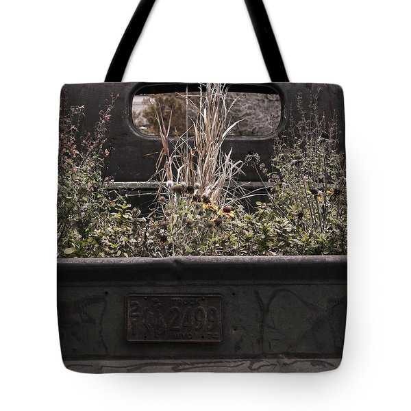 Tote Bag featuring the photograph Flower Bed - Nature And Machine by Steven Milner