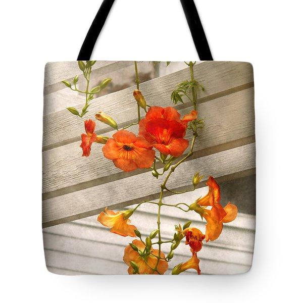 Flower - Trumpet Melodies Tote Bag by Mike Savad
