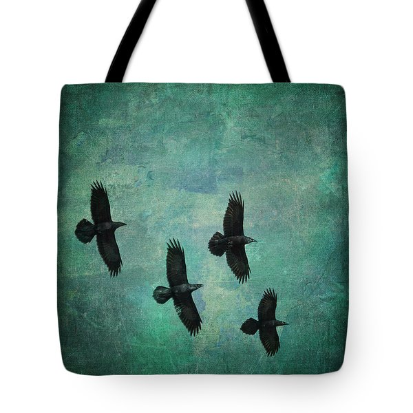 Tote Bag featuring the photograph Flying Ravens by Peggy Collins