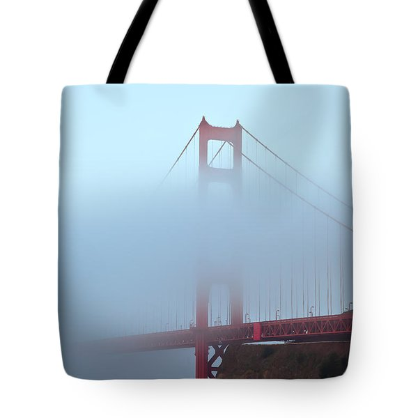 Tote Bag featuring the photograph Fog And The Golden Gate by Jonathan Nguyen