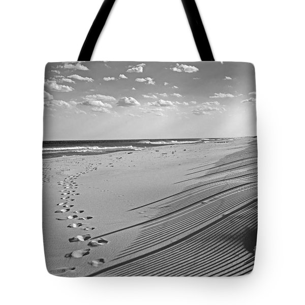 Tote Bag featuring the photograph Footprints In The Sand by Debra Fedchin