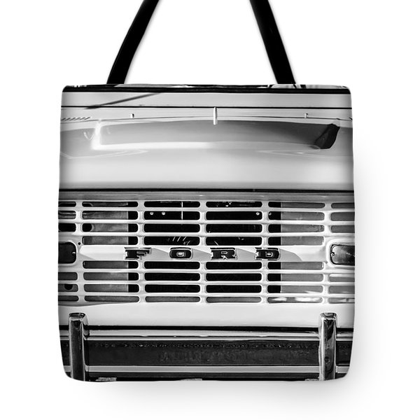 Tote Bag featuring the photograph Ford Bronco Grille Emblem -0014bw by Jill Reger