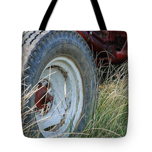 Tote Bag featuring the photograph Ford Tractor Tire by Jennifer Ancker