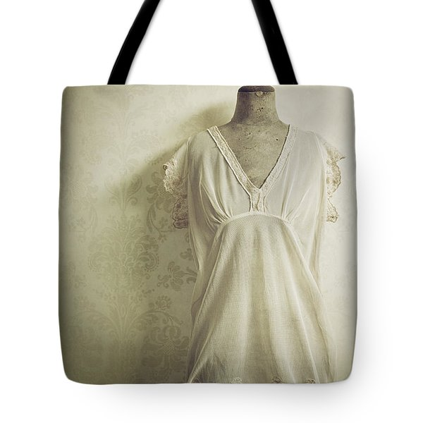 Tote Bag featuring the photograph Forgotten Beauty by Amy Weiss
