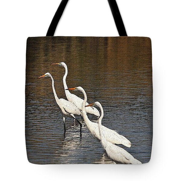 Tote Bag featuring the photograph Four Egrets Fishing by Tom Janca