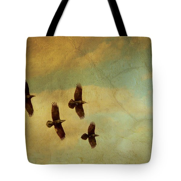 Tote Bag featuring the photograph Four Ravens Flying by Peggy Collins