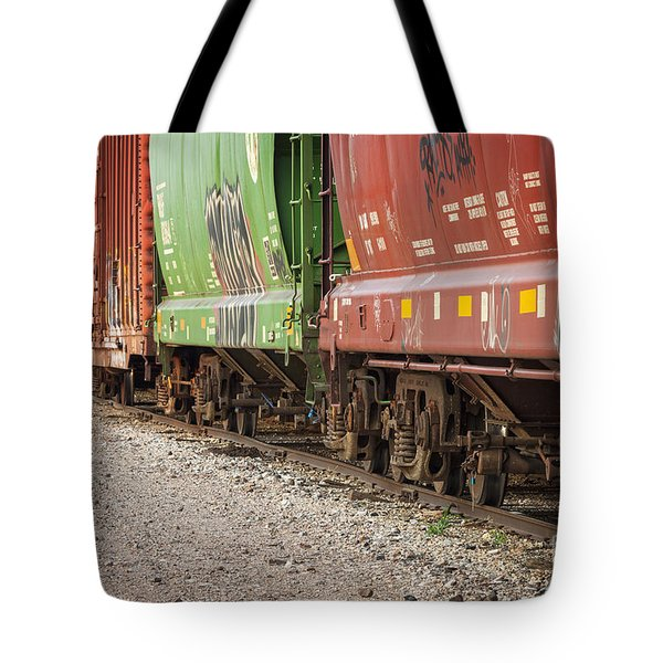 Tote Bag featuring the photograph Freight Train Cars On Tracks by Bryan Mullennix