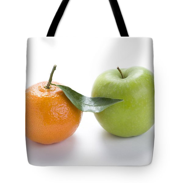 Tote Bag featuring the photograph Fresh Apple And Orange On White by Lee Avison