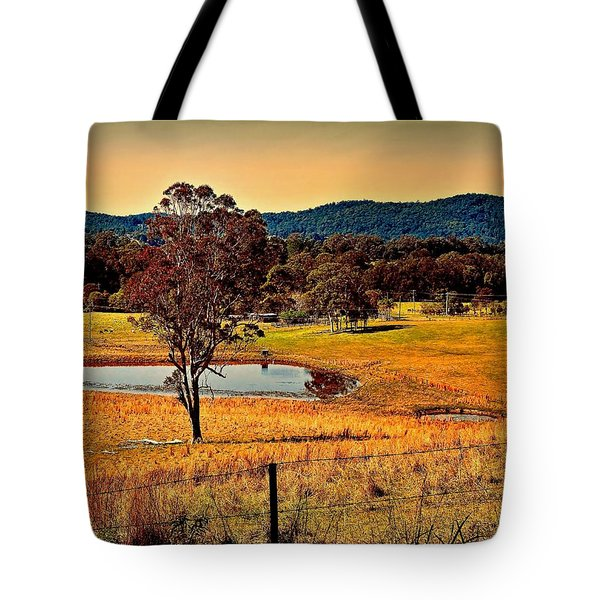 Tote Bag featuring the photograph From A Distance by Wallaroo Images