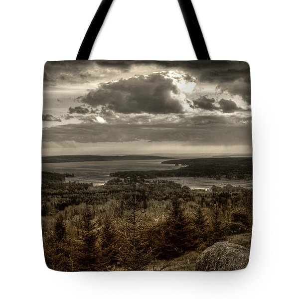 Tote Bag featuring the photograph From Awanadjo by Greg DeBeck
