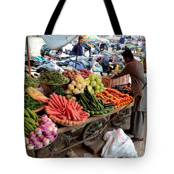 Fruit And Vegetable Seller Tends To His Cart Outside Empress Market Karachi Pakistan Tote Bag